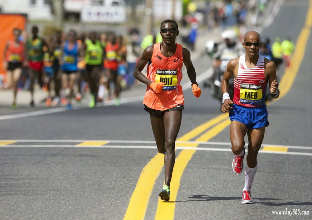 Apr 21, 2014; Boston, MA, USA; Elite runners Josphat Boit (left) and Meb Keflezighi (right) race during the 2014 Boston Marathon. Mandatory Credit: David Butler II-USA TODAY Sports