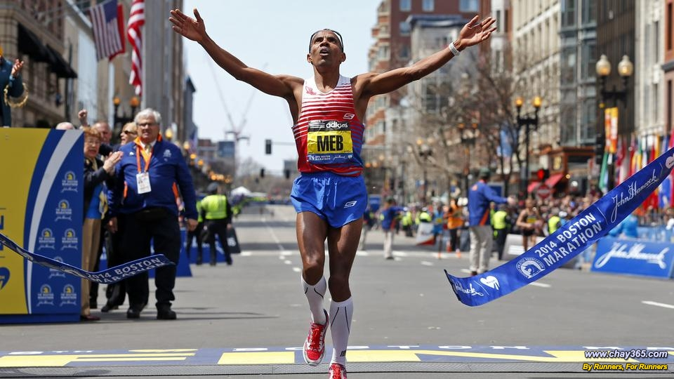 (Boston, MA, 04/21/14) Meb Keflezighi, a 38-year-old immigrant from war-torn Eritrea, the first American man to win the Boston Marathon in more than 30 years, crosses the finish line. The 118th running of the Boston Marathon and the first since the bombing at the finish line last year on Monday, April 21, 2014. Staff Photo by Nancy Lane